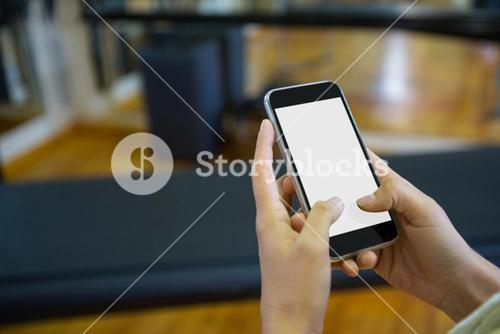 Hand on a woman using mobile phone
