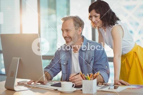 Graphic designers using graphics tablet