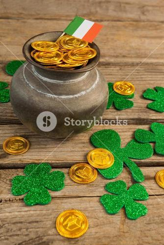 St. Patricks Day pot of chocolate gold coins with irish flag and shamrocks
