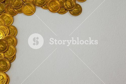 St Patricks Day gold chocolate coins forming corner frame
