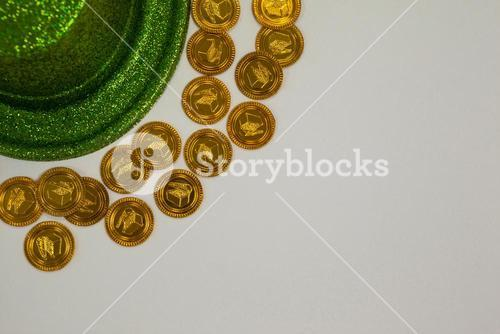 St Patricks Day leprechaun hat surround with gold chocolate coins