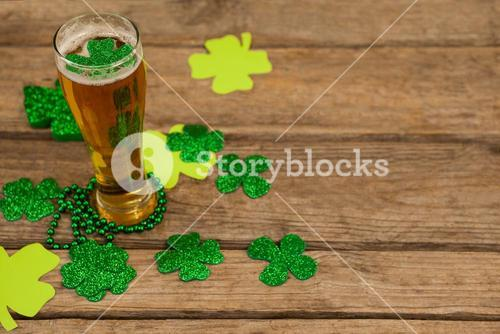 Glass of beer, beads and shamrock for St Patricks Day