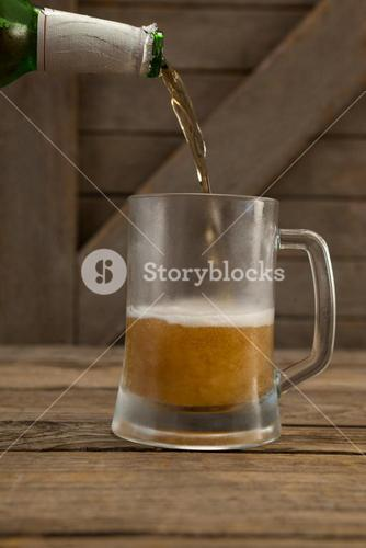 Beer being poured into a mug