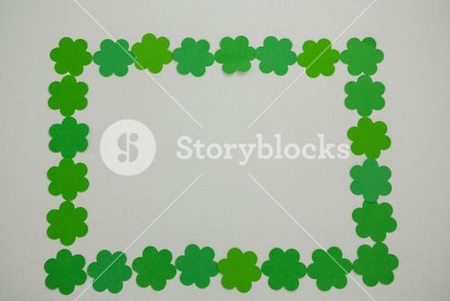 St Patricks Day shamrocks forming rectangle frame