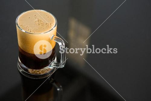Black beer on glass table
