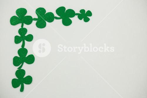 St Patricks Day shamrocks forming corner frame