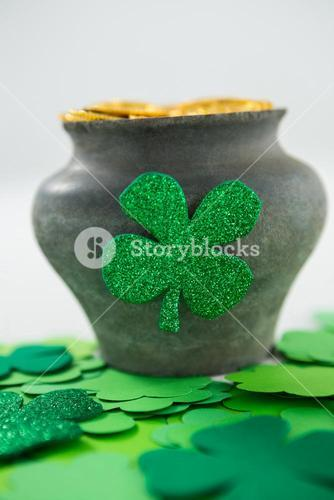 St. Patricks Day shamrocks and pot filled with chocolate gold coins