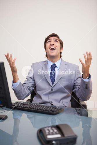Businessman screaming out loud