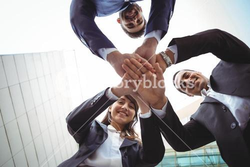 Businesses executives forming a hand stack