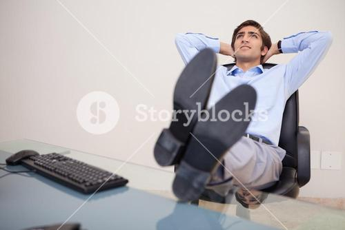 Businessman leaning back in his chair