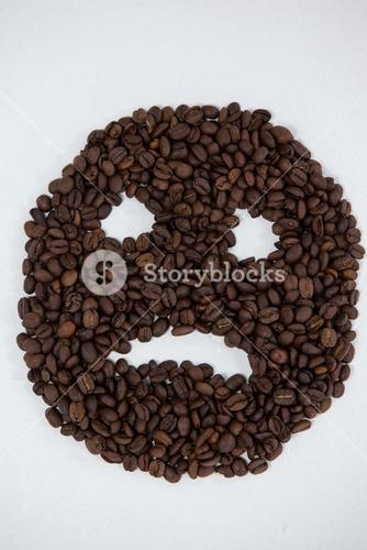 Coffee beans forming sad face