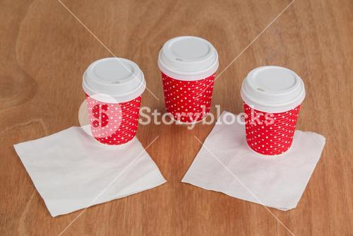 Three disposable coffee cup with tissue paper