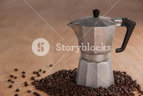 Metallic coffee maker with coffee beans
