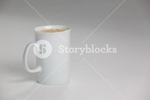 White mug of coffee with creamy froth