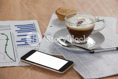 Coffee cup with document and mobile phone