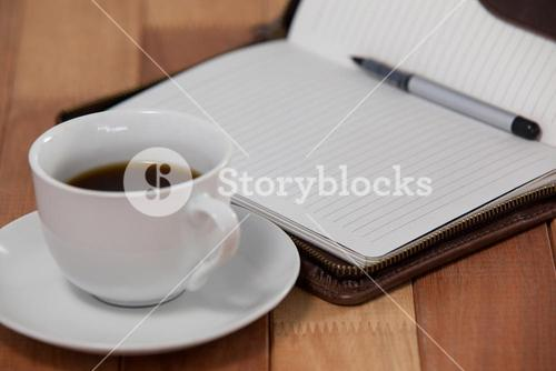 Black coffee with organizer and pen
