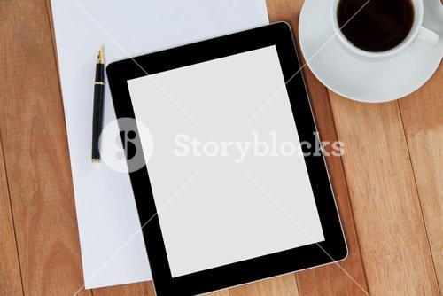 Black coffee with digital tablet and paper
