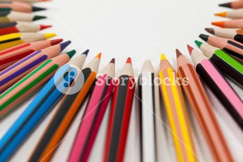 Colored pencils arranged in a semi-circle
