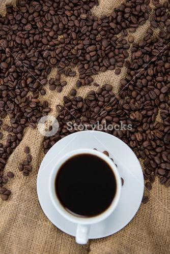 Black coffee and coffee beans on sack