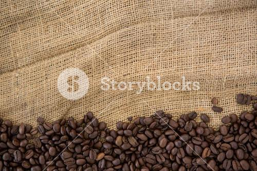 Coffee beans arranged on sack
