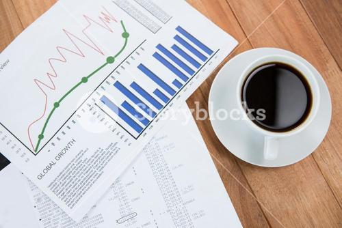 Coffee cup and graph document