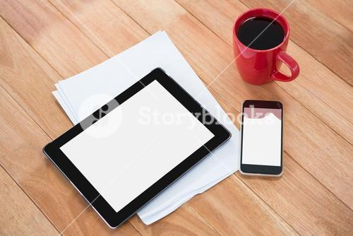 Coffee with digital tablet and mobile phone