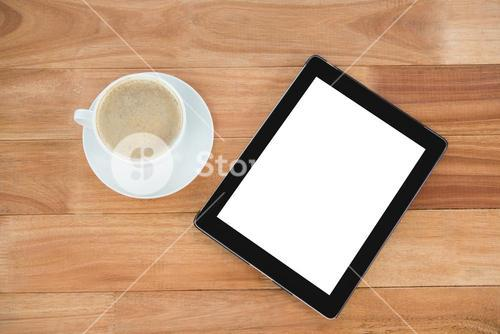 Coffee cup with digital tablet