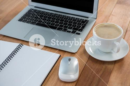 Coffee with organizer and laptop