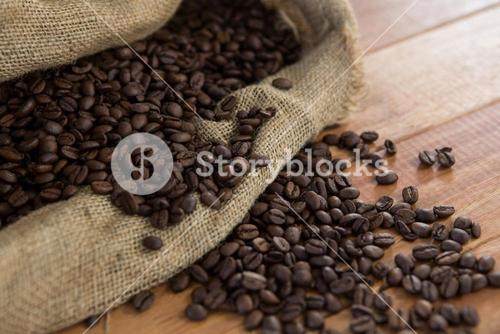 Roasted coffee beans in sack bag
