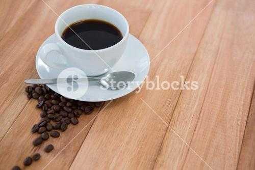 Black coffee with roasted coffee beans