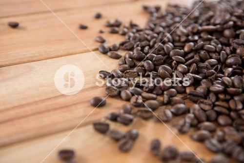Roasted coffee beans spilled