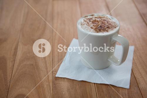 Coffee served in white mug with tissue
