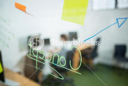 Sticky note and written text on glass wall