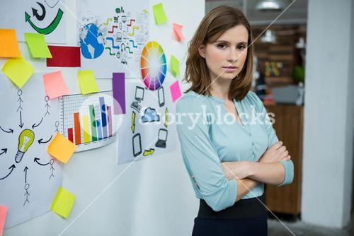 Female graphic designer standing with hands crossed