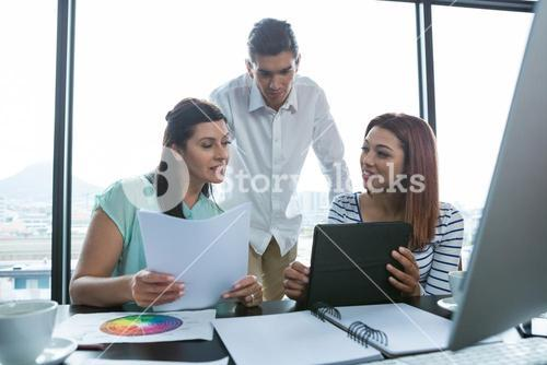 Man and women working in office