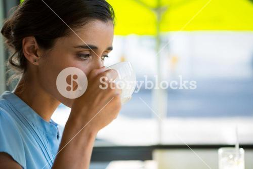 Female executive drinking coffee