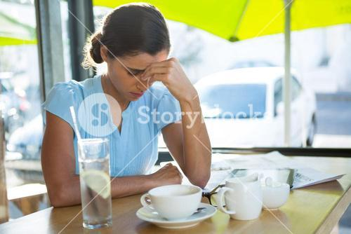 Female executive sitting at café