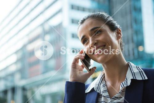 Business executive talking on mobile phone