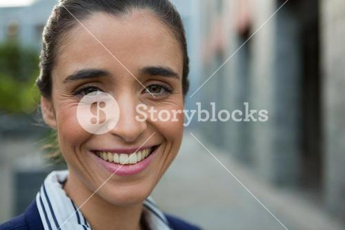 Smiling business executive on city street