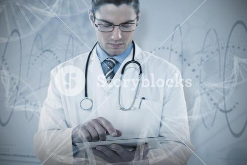 Composite image of young doctor using digital tablet