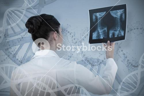 Composite image of female doctor checking x-ray report