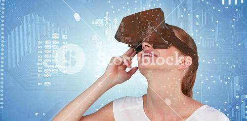 Composite image of close up of woman using virtual reality headset
