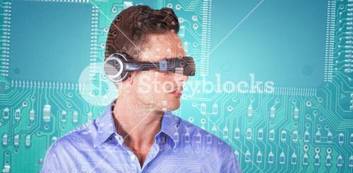 Composite image of handsome young man with virtual reality simulator