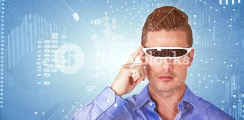 Composite image of handsome man with virtual video glasses