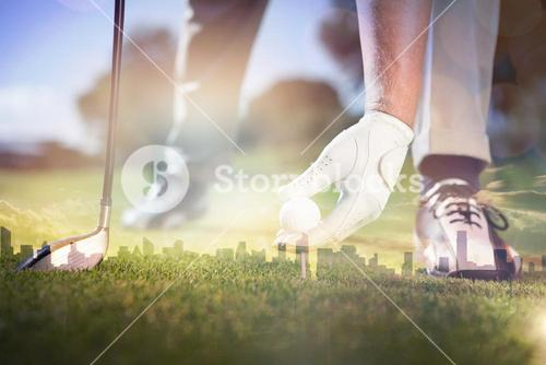 Composite image of golfer placing golf ball on tee