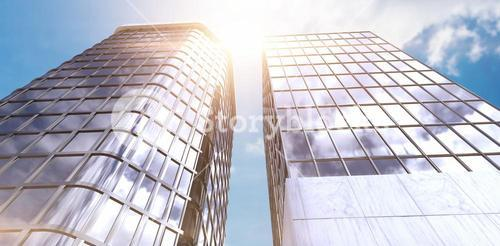 Composite image of low angle view of modern office building