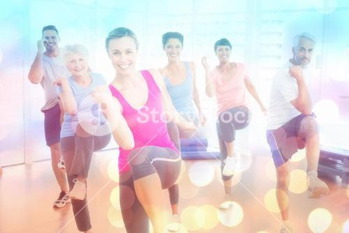 Composite image of smiling people doing power fitness exercise at yoga class