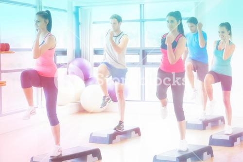 Composite image of instructor with fitness class performing step aerobics exercise