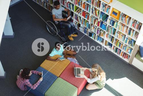 Attentive students studying in library