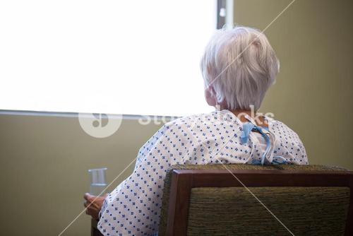 Senior patient siting on chair